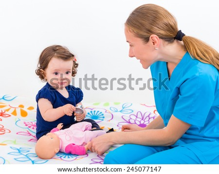 Photo of an adorable baby and the doctor - stock photo