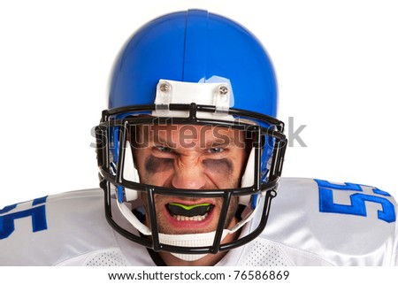 Photo of an American football player, cut out on a white background. - stock photo