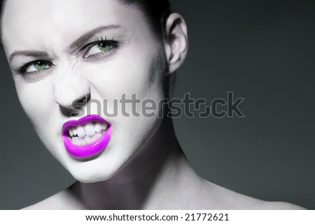 photo of an angry girl on gray background - stock photo