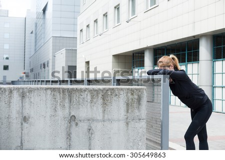Photo of an attractive female resting after jogging - stock photo