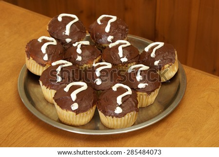 Photo 1 of an event held in revealing the gender of a new mothers baby done in a unique photo series using mystery cupcakes to let people know if its a boy or girl.  - stock photo