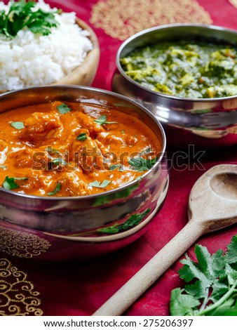 Photo of an Indian meal of Butter Chicken, rice and Saag Paneer - stock photo