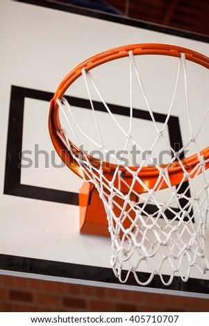 Photo of an indoor basketball hoop. - stock photo