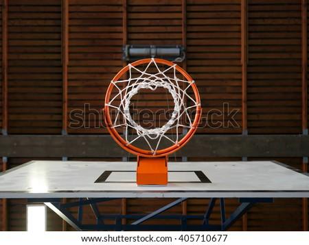 Photo of an indoor basketball hoop from below. - stock photo