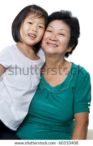 Photo of Asian grandmother and granddaughter on white background. - stock photo