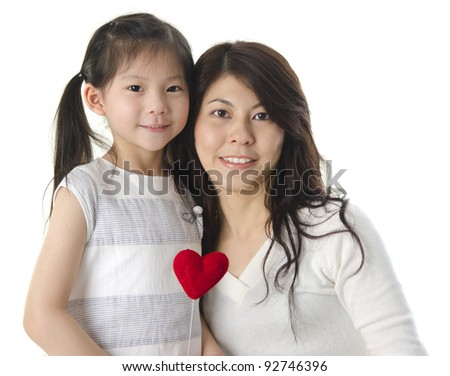 Photo of Asian mother and daughter on white background - stock photo