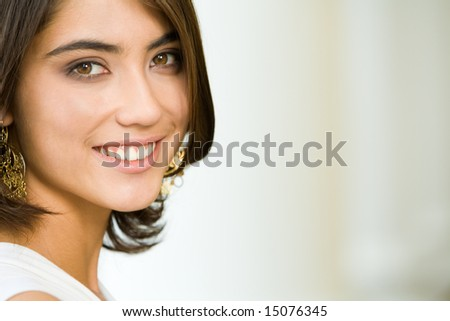 Photo of attractive lady with charming smile looking at camera - stock photo