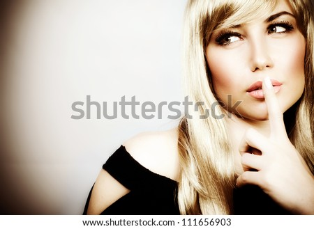 Photo of attractive woman expression silent, picture of mysterious girl show hush gesture, closeup portrait of young mum sign shh, image of blonde female with finger near lips, concept of silence - stock photo