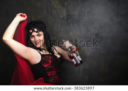 photo of Beautiful brunette woman in corset and long hair - stock photo