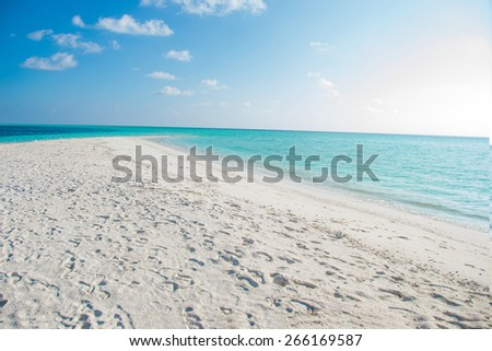 photo of beautiful empty tropical paradise beach with white sand and turquoise water - stock photo