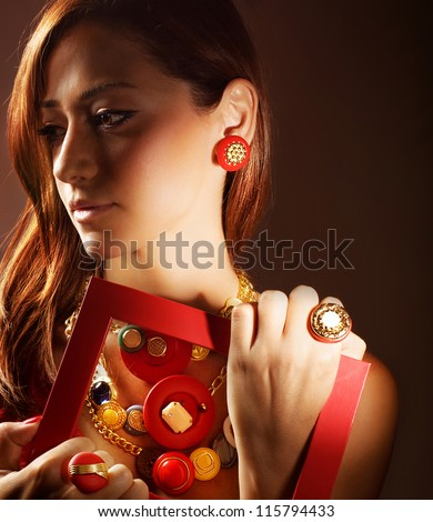 Photo of beautiful girl wearing stylish colorful accessories, closeup portrait of pretty woman in luxury jewelry isolated on brown background, glamour young lady, fashion and style concept - stock photo