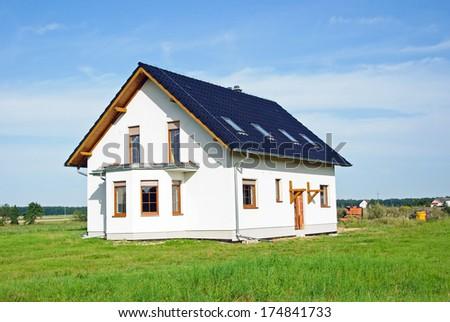 Photo of beautiful new wihte house - stock photo