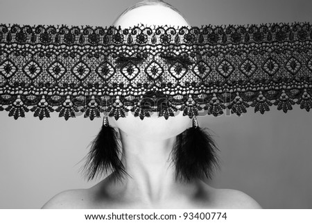 Photo of beautiful young woman with lace. The Black-and-white photo - stock photo