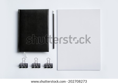 Photo of blank letterheads and note with pencil isolated on white - stock photo