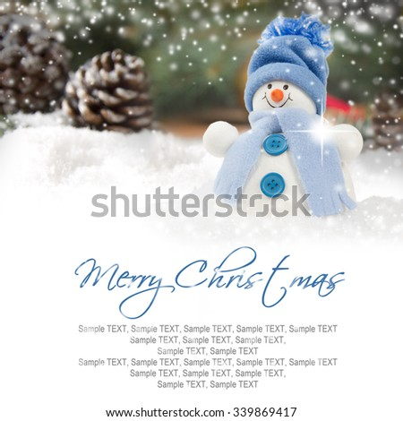 Photo of blue snowman on wooden board background with falling snow and white space - stock photo