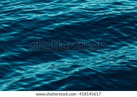 Photo of blue water background with ripples - stock photo