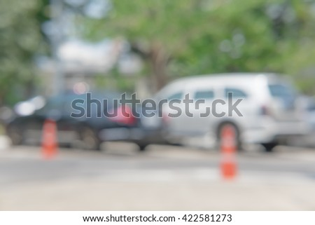 Photo of blurred parked cars in the city - stock photo