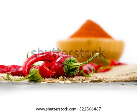 Photo of bowl full of red pepper spice on burlap with white space - stock photo