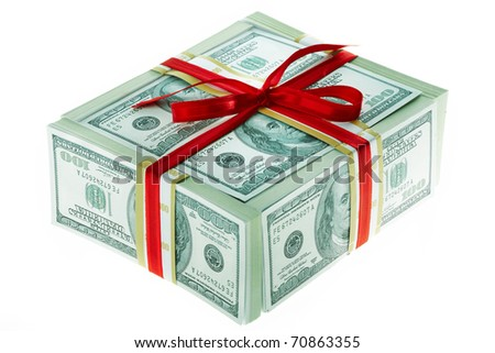 Photo of box made up of dollars decorated with red ribbon over white background - stock photo