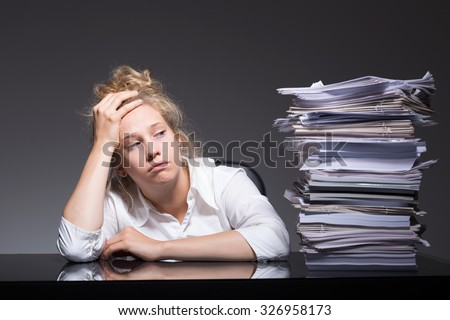 Photo of burnout office worker lying on desk - stock photo