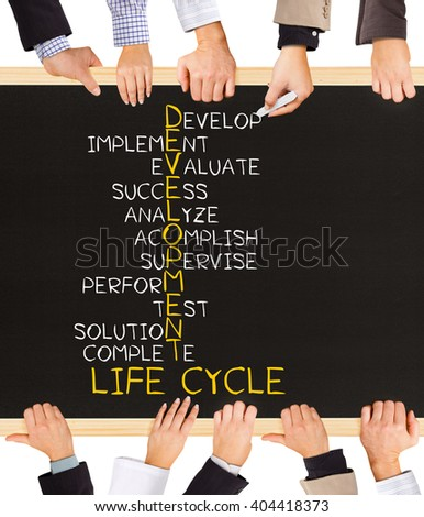 Photo of business hands holding blackboard and writing DEVELOPMENT LIFE CYCLE concept - stock photo