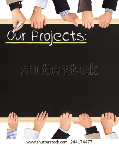 Photo of business hands holding blackboard and writing Our Projects - stock photo