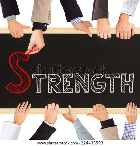 Photo of business hands holding blackboard and writing STRENGTH concept - stock photo