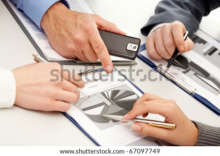Photo of business people hands working with documents at briefing - stock photo