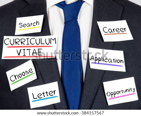 Photo of business suit and tie with CURRICULUM VITAE conceptual words written on paper cards - stock photo