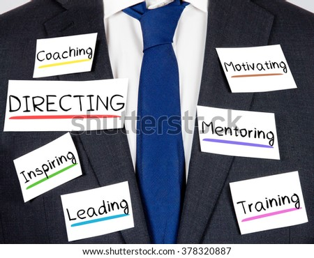 Photo of business suit and tie with DIRECTING concept paper cards - stock photo