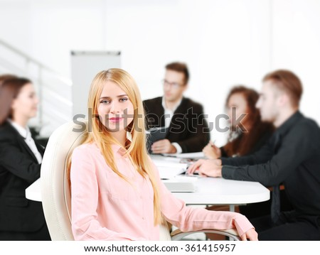 Photo of business woman with her staff in conference room at the meeting - stock photo