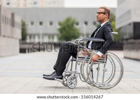Photo of businessman on wheelchair - stock photo
