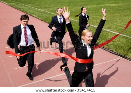 Photo of businesspeople crossing the finish line - stock photo