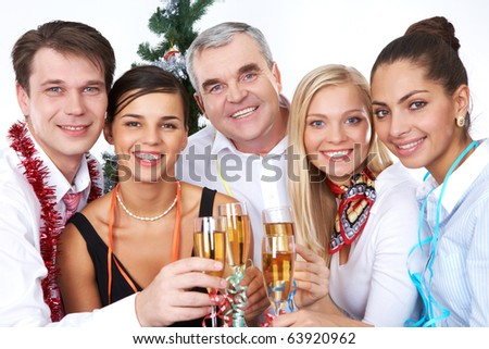 Photo of businesspeople with flutes of sparkling champagne - stock photo