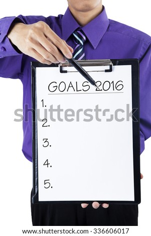 Photo of businessperson holding a clipboard and showing the lists number to make plan or goals in 2016 - stock photo