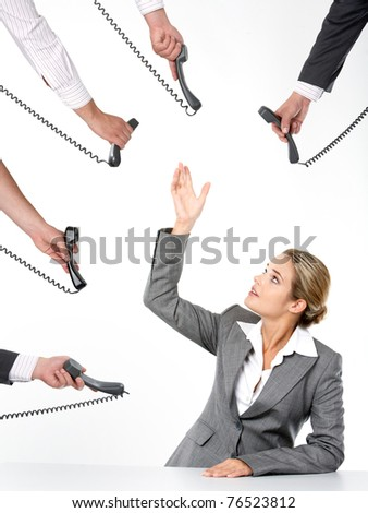Photo of businesswoman going to take telephone receiver while being offered several of them - stock photo