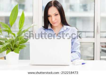Photo of caucasian businesswoman with notebook working in home office - stock photo