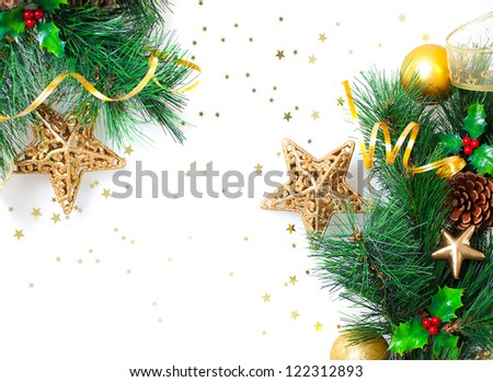 Photo of Christmastime border, Christmas tree branch decorated with golden stars, ribbons, bubbles and fir cones isolated on white background, festive floral frame, New Year greeting card - stock photo