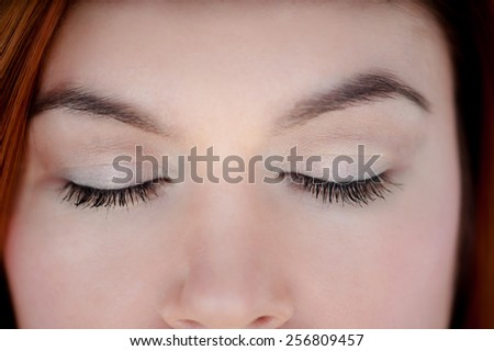 Photo of closed eyes, a beautiful professional make-up, - stock photo