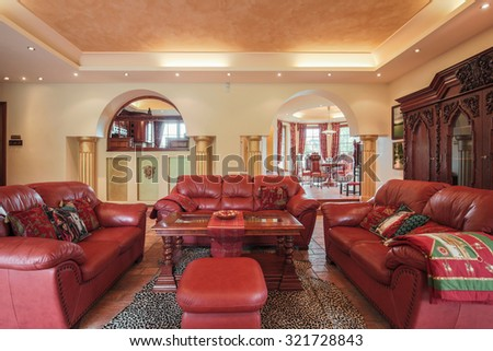 Photo of colonial style living room with leather furniture - stock photo
