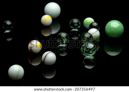 photo of color marbles on black with reflection - stock photo