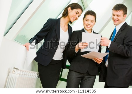 Photo of confident business people discussing a new project at meeting - stock photo