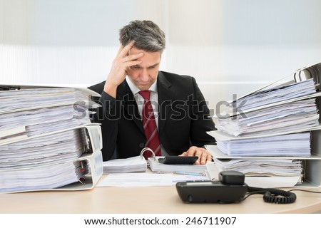 Photo Of Contemplated Businessman Working At Office - stock photo