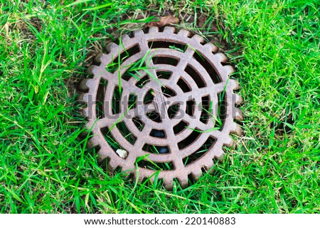 Photo of  Cover Drain on a green lawn - stock photo