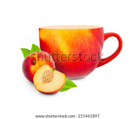 Photo of cup made of fruit skin with peach and slice - stock photo