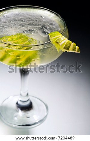 Photo of daikiri cocktail with slices of lime - stock photo