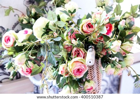 photo of decorative the bicycle with artificial roses - stock photo