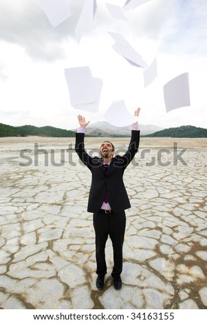Photo of delighted businessman standing and throwing papers outdoors - stock photo