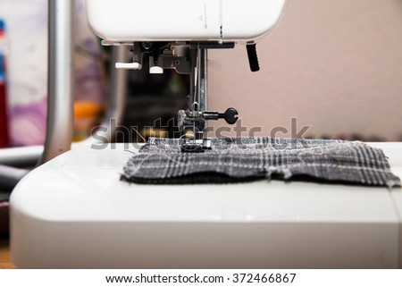 photo of Detail of sewing machine and sewing accessories. - stock photo