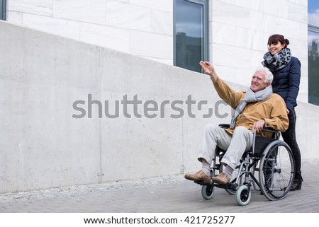 Photo of disabled retiree spending time outdoors - stock photo